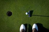 Golfer's eye view of a putt
