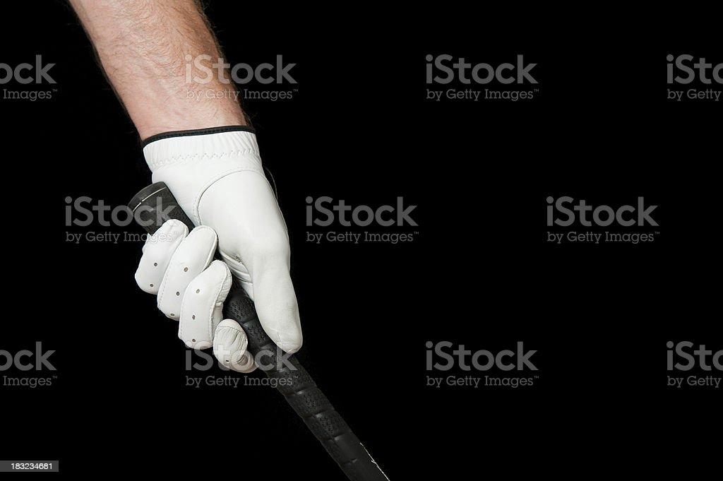 Golfer's hand gripping club stock photo
