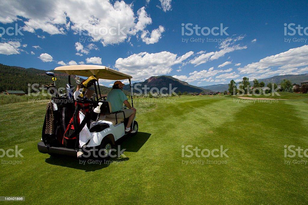 golfers in golf cart stock photo