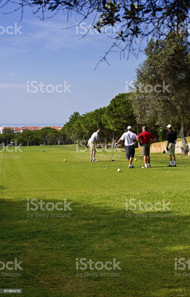 Golfers on a Portuguese golf course royalty-free stock photo