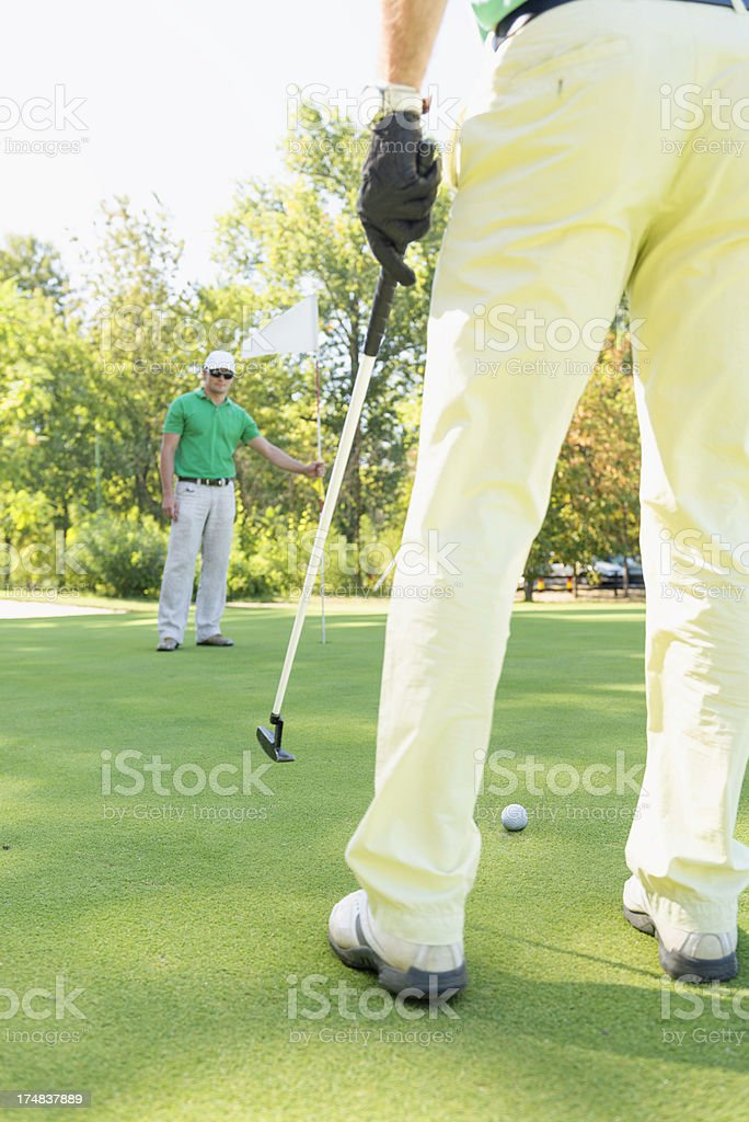 Golfers on green royalty-free stock photo