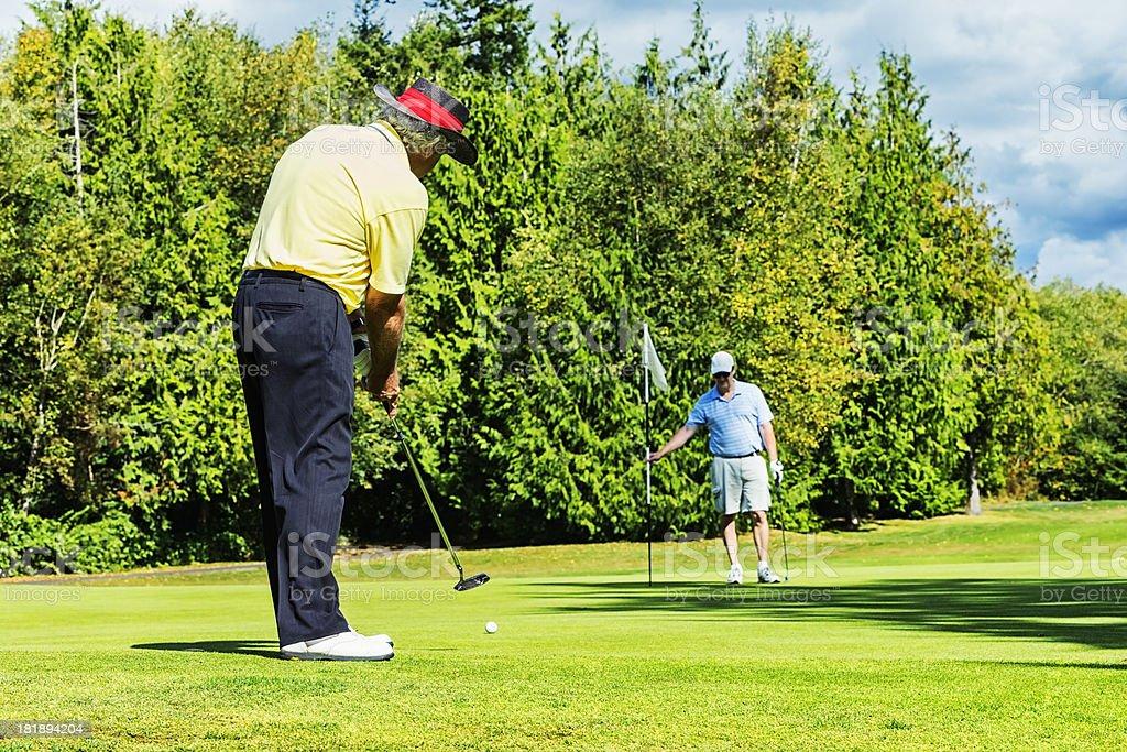 Golfers on Putting Green stock photo