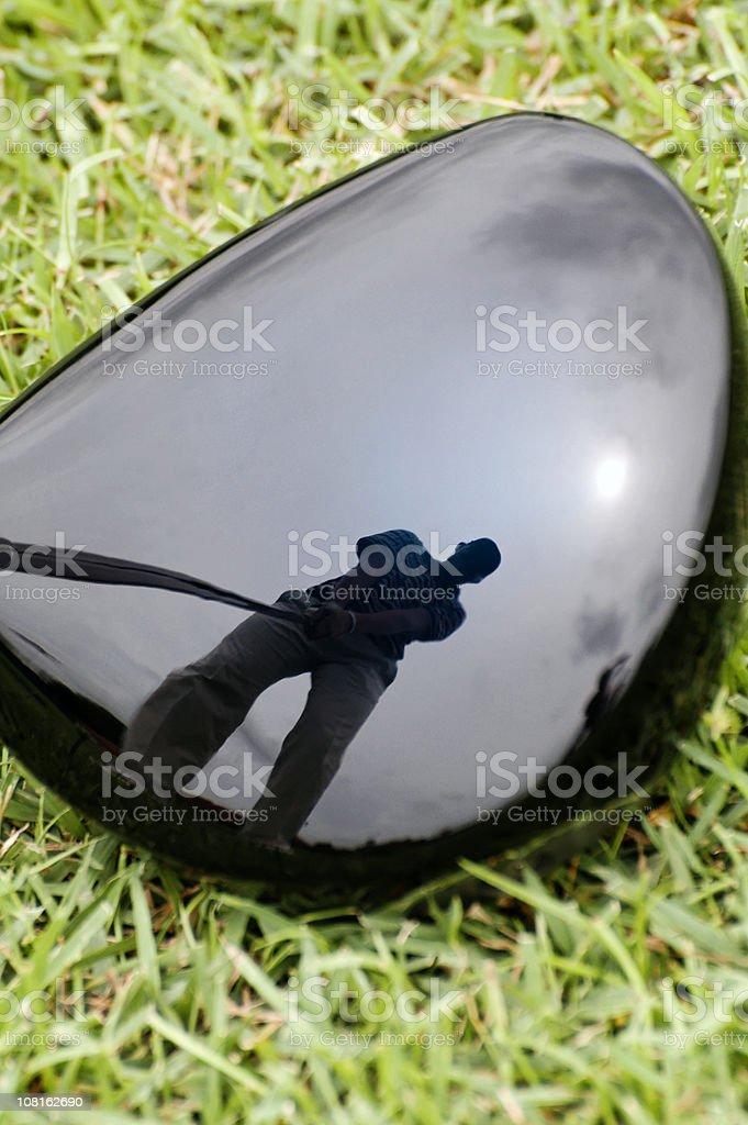 Golfer's reflection in Golf Club Head royalty-free stock photo