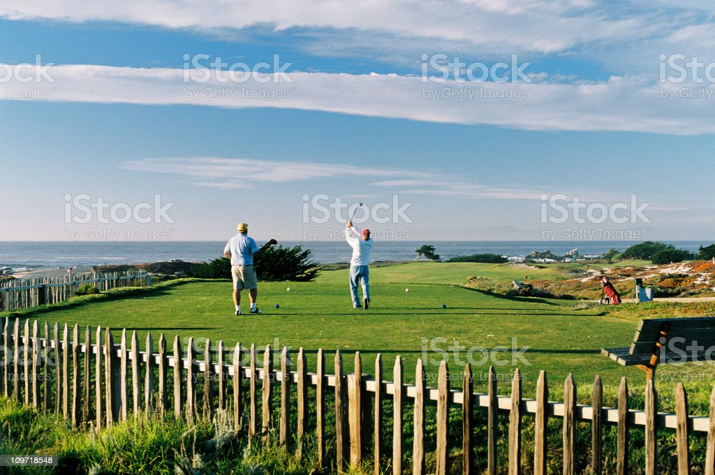 Golfers Tee Off on Monterey California ocean front Golf Course royalty-free stock photo