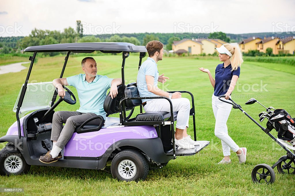 Golfing companions on golf course stock photo