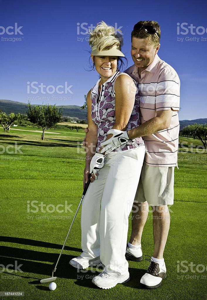 Golfing Couple royalty-free stock photo