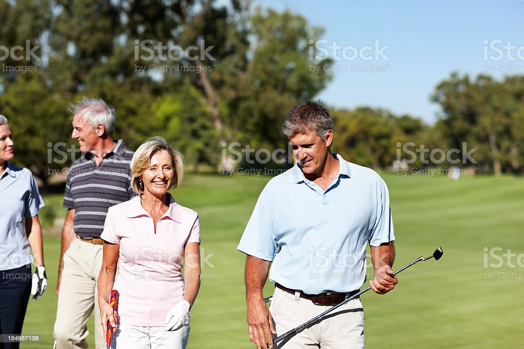 Golfing couples chatting royalty-free stock photo