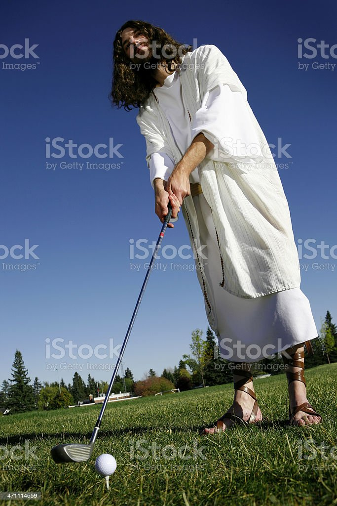 Golfing Jesus stock photo