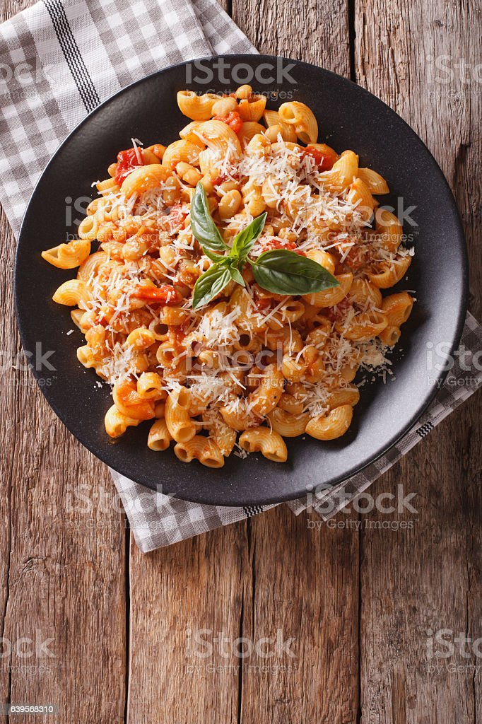 gomiti pasta with white beans and cheese close-up stock photo