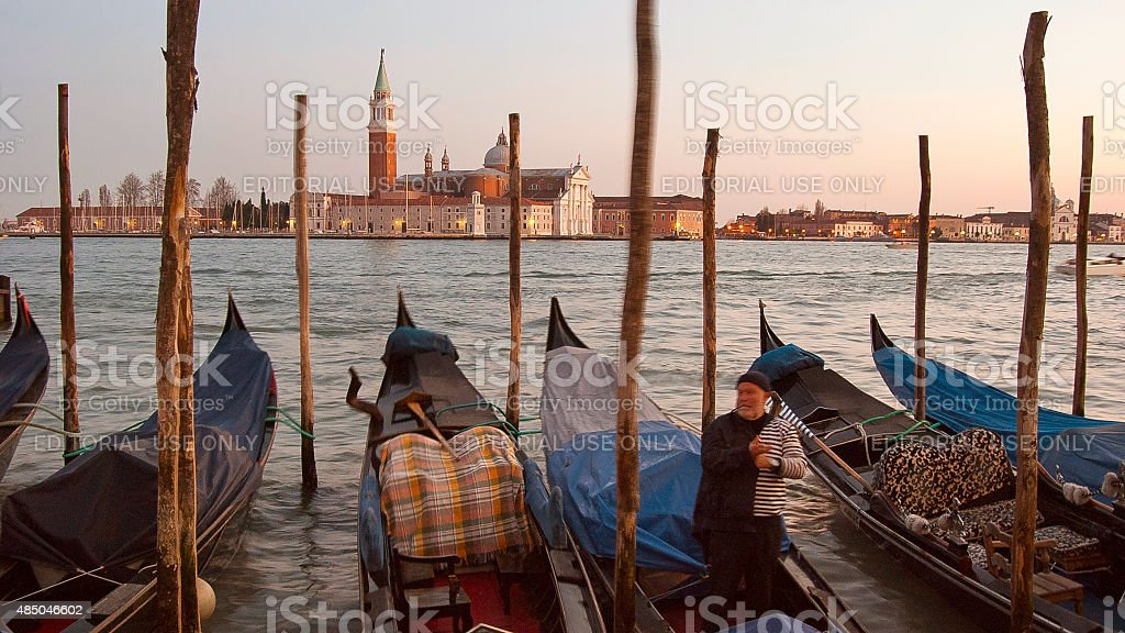 Gondalas moored on a quay in Venice, Italy stock photo