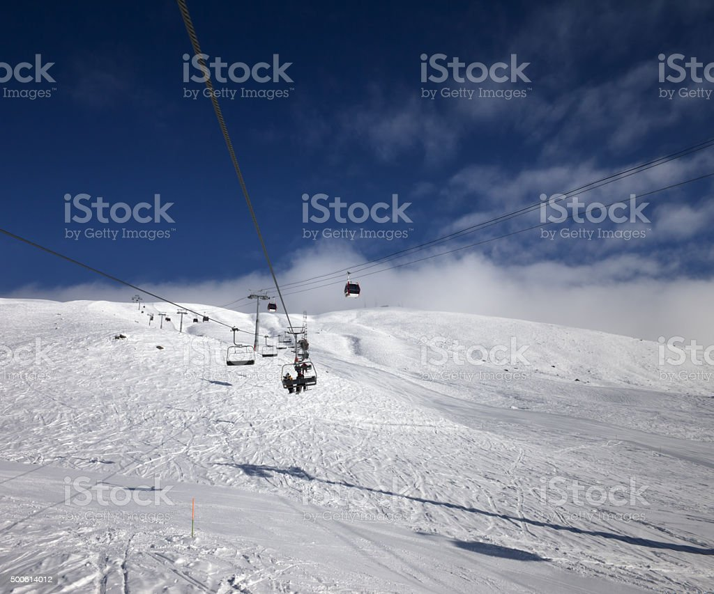 Gondola and chair lift at ski resort in nice day stock photo