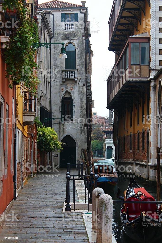 Gondola and colorfull houses stock photo