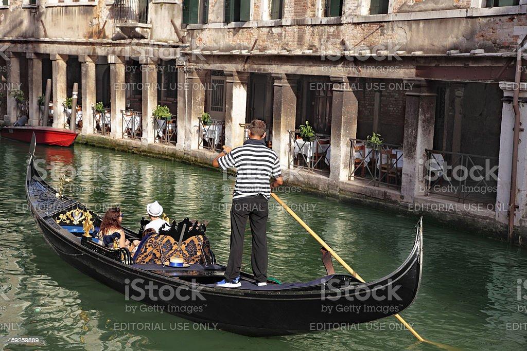 Gondola and restaurant in Venice royalty-free stock photo