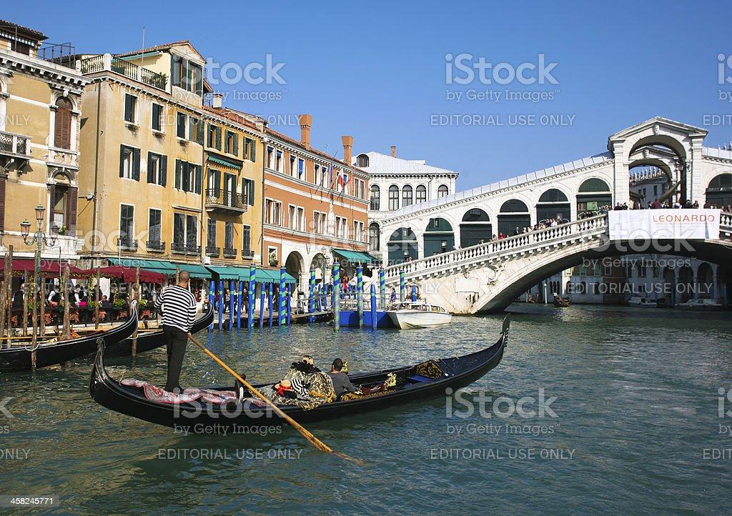 Gondola at Rialto bridge royalty-free stock photo