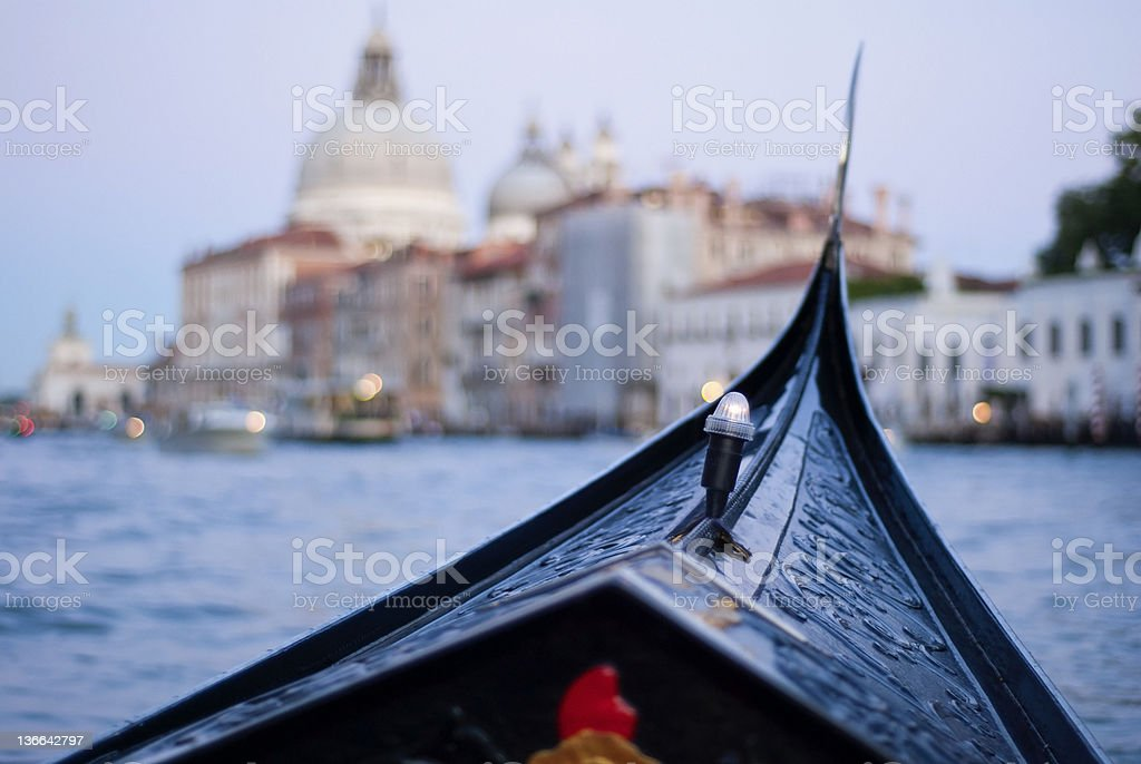 Gondola at twilight in Venice on GrandCanal. Inside view royalty-free stock photo