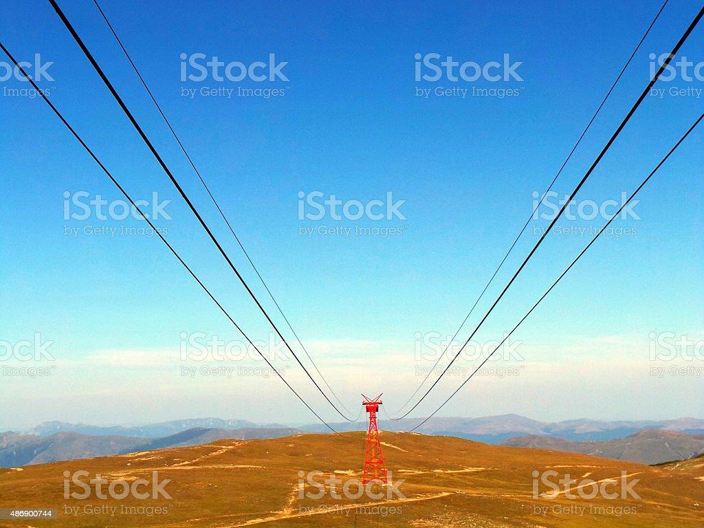 Gondola cable in Alps Mountains stock photo