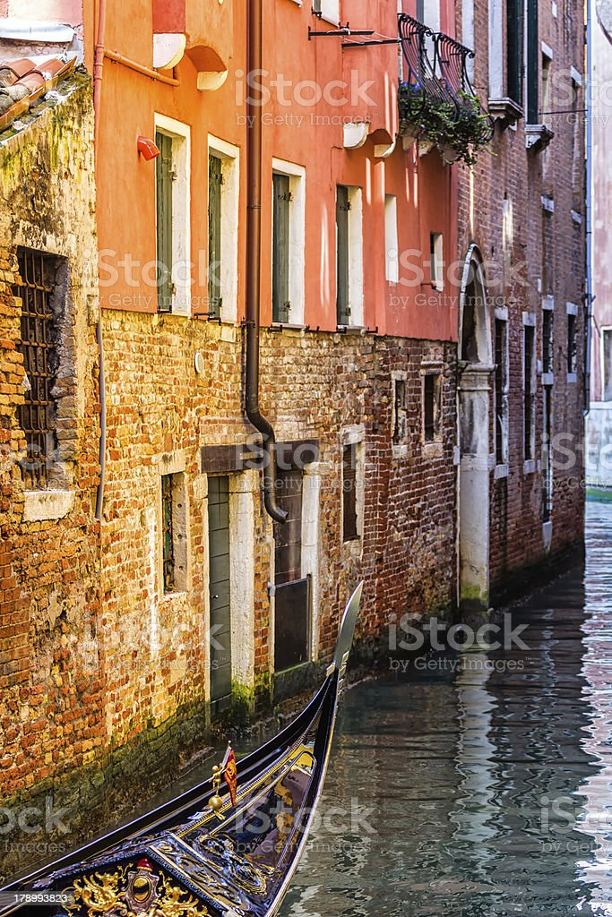 Gondola Crossing a Canal in Venice. Italy royalty-free stock photo