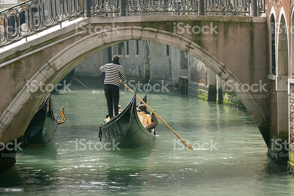 Gondola in Venice under old bridge (XXL) stock photo