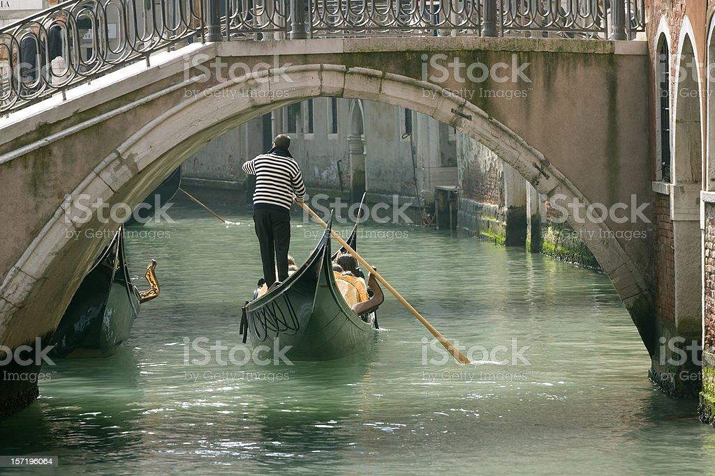 Gondola in Venice under old bridge (XXL) stock photo