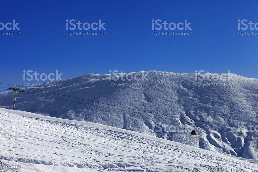 Gondola lift and off-piste slope royalty-free stock photo