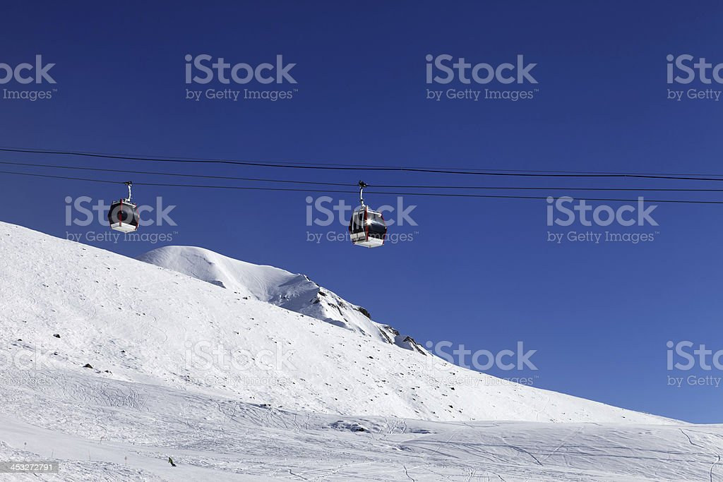 Gondola lift and ski slope royalty-free stock photo