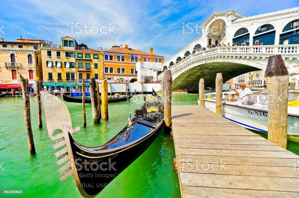 Gondola moored on the Grand Canal in Venice stock photo
