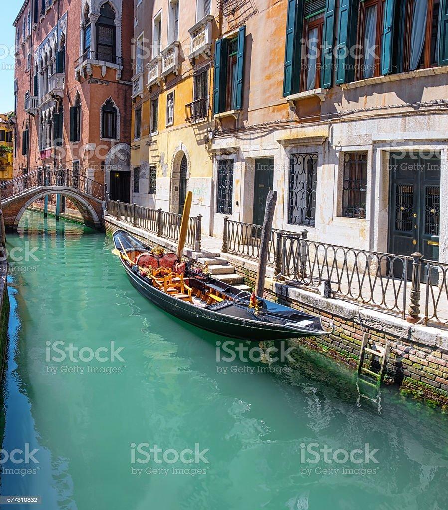 Gondola, old buildings and bridge in central Venice stock photo