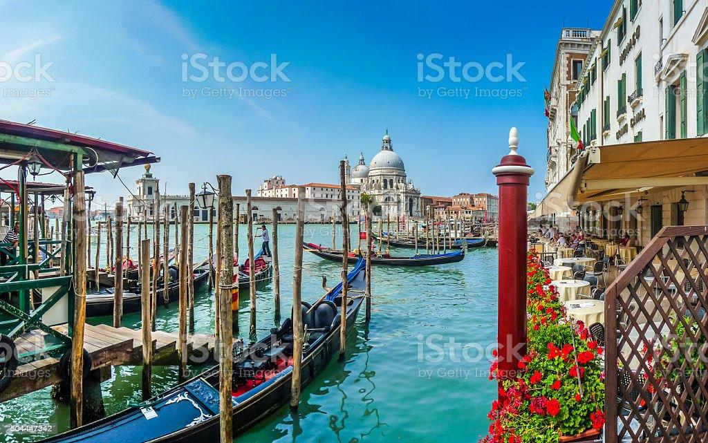 Gondola on Canal Grande with Basilica di Santa Maria, Venice stock photo