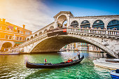 Gondola on Canal Grande with Rialto Bridge at sunset, Venice