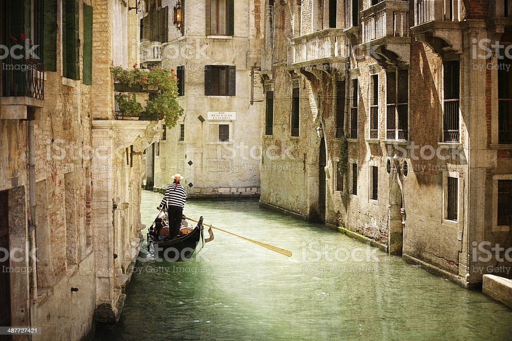 Gondola on canal in Venice stock photo