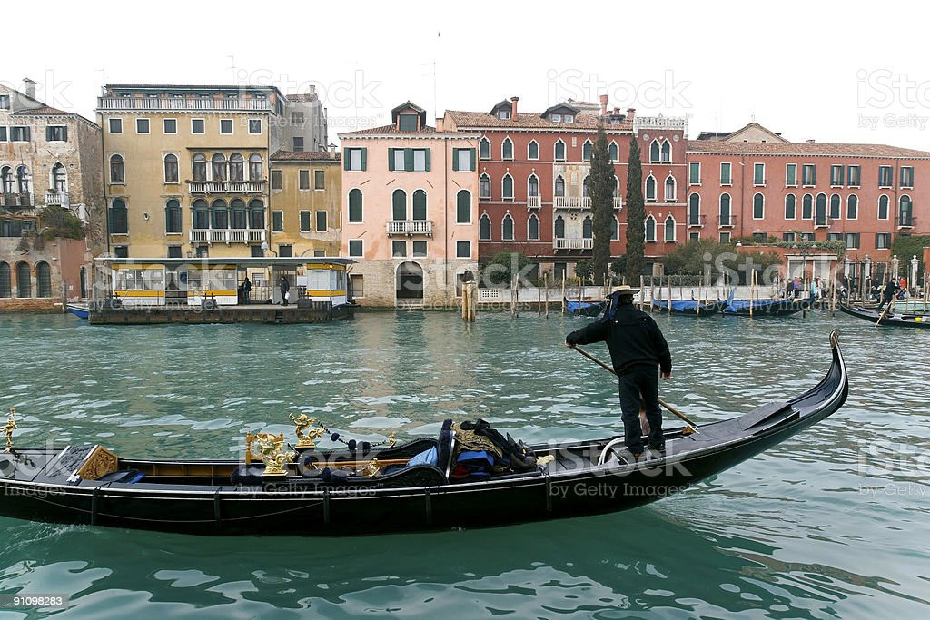 Gondola on Grand Canal with historical palaces in Venice stock photo