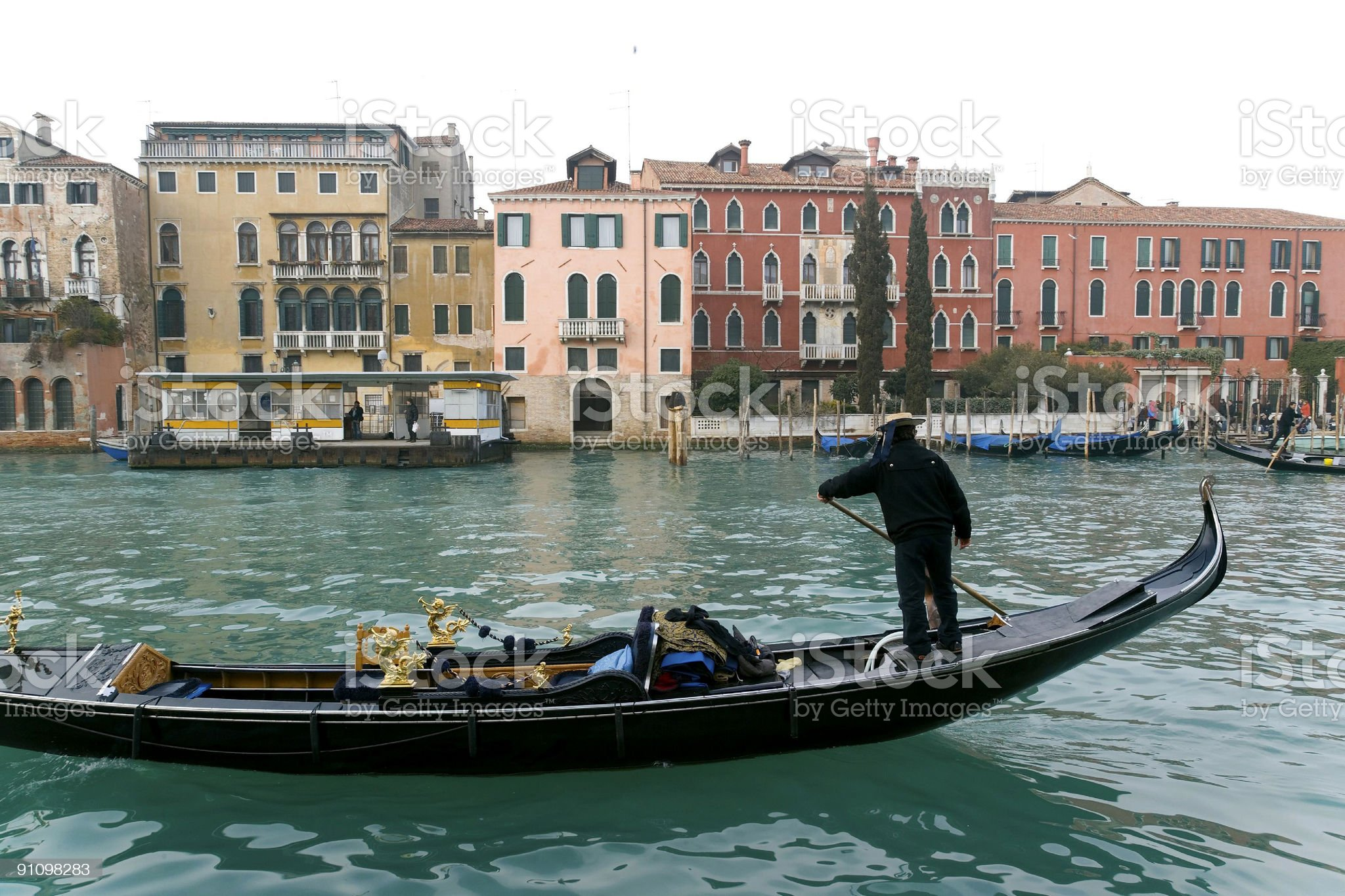 Gondola on Grand Canal with historical palaces in Venice royalty-free stock photo