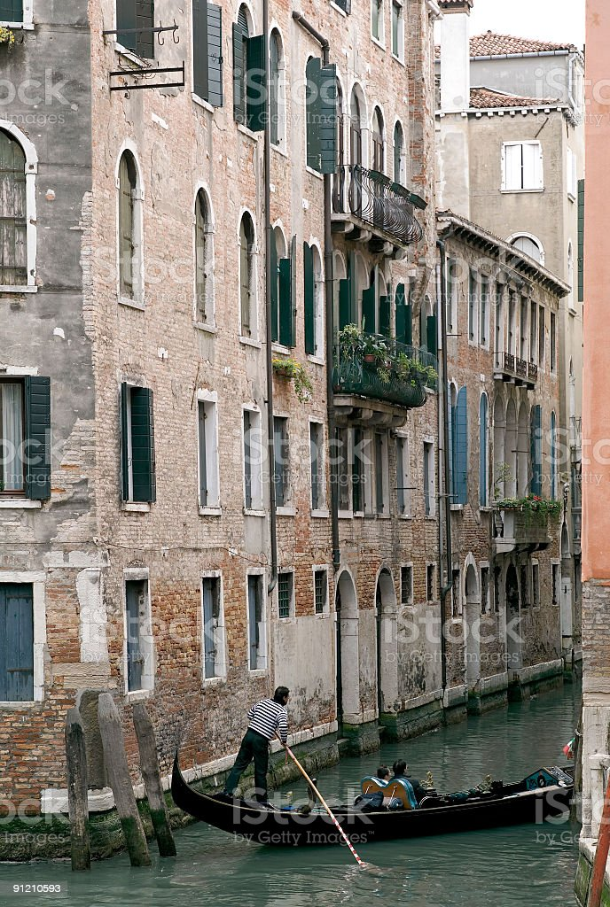 Gondola on small canal in Venice royalty-free stock photo