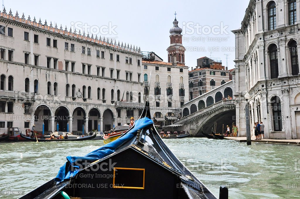 Gondola on the Venetian Grand Canal with the Rialto Bridge. stock photo