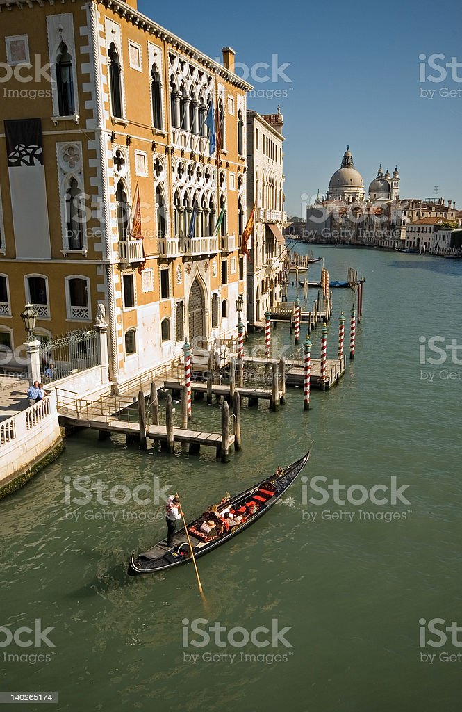 Gondola passing by on the Grand Canal stock photo