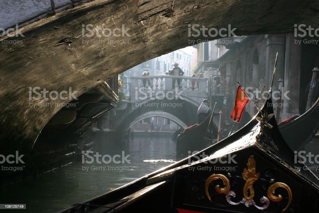 Gondola Ride Under Bridge royalty-free stock photo