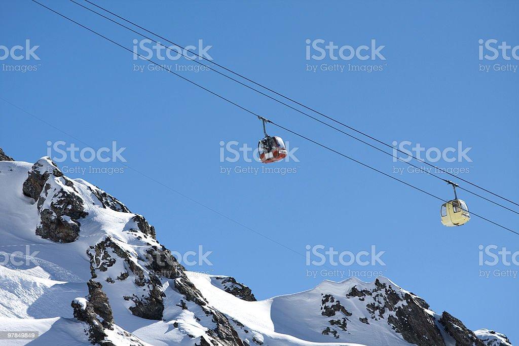 Gondola ski lift in high mountains royalty-free stock photo