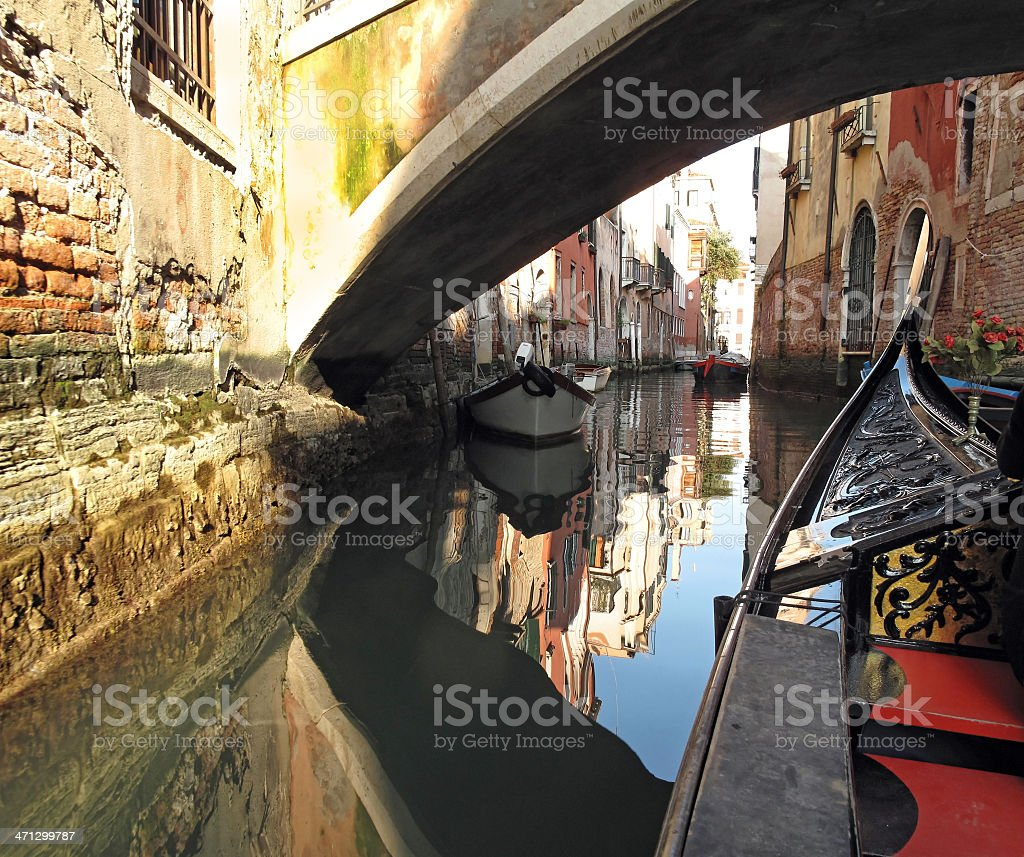 Gondola under a bridge in Venice royalty-free stock photo
