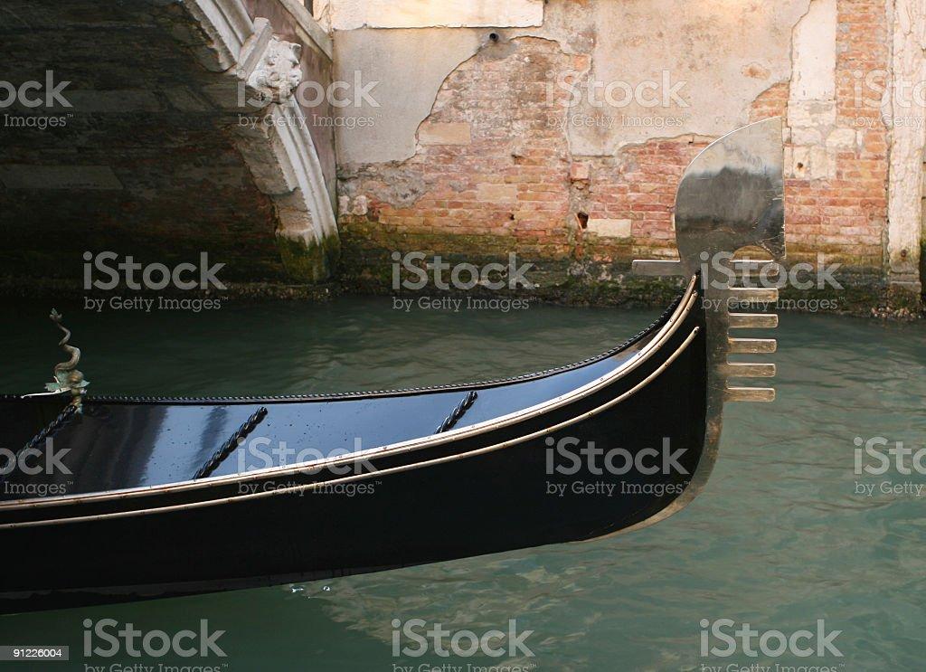 Gondola under a bridge in Venice royalty-free stock photo