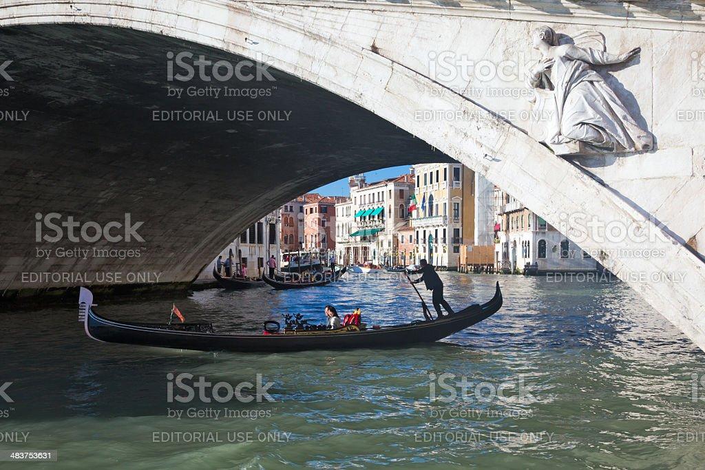 Gondola under Rialto bridge in Venice Italy royalty-free stock photo