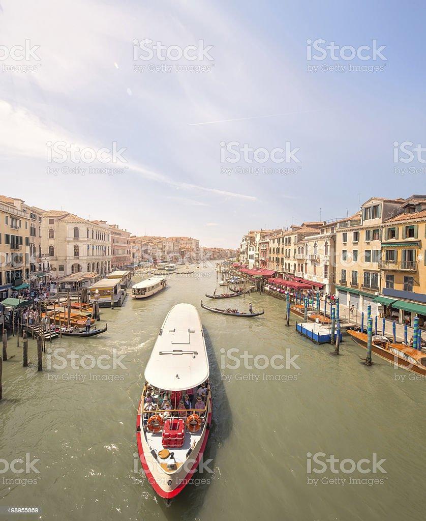 Gondola with gondolier and vaporetto station stock photo