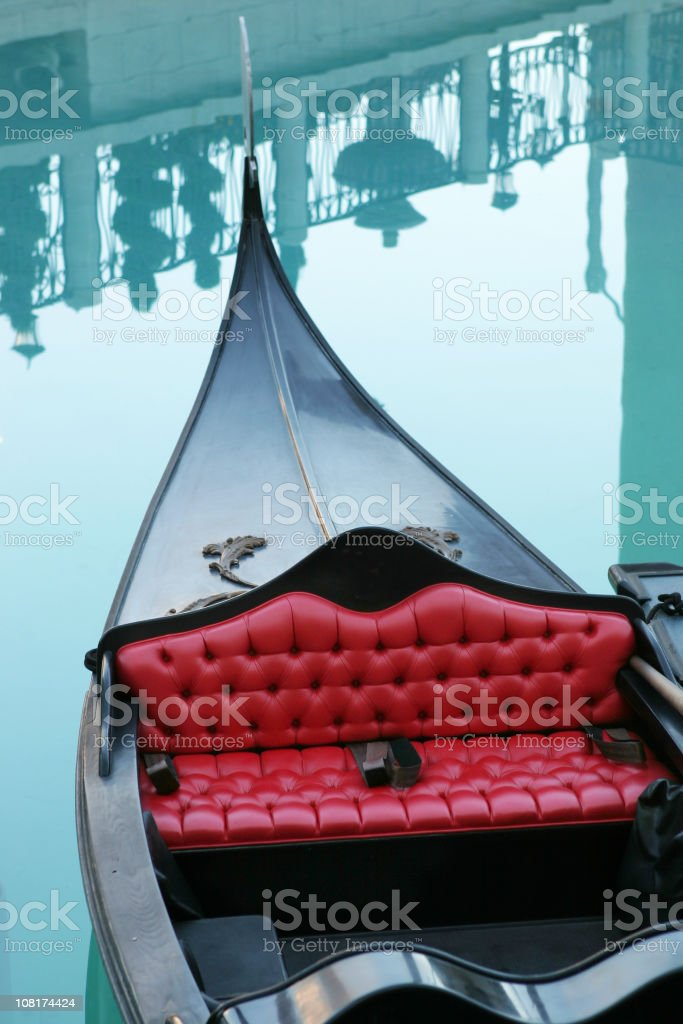 Gondola with Reflections of Railing in Water royalty-free stock photo