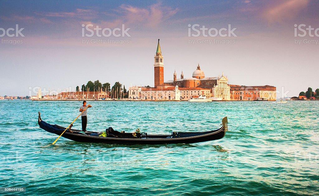 Gondola with San Giorgio Maggiore at sunset, Venice, Italy stock photo