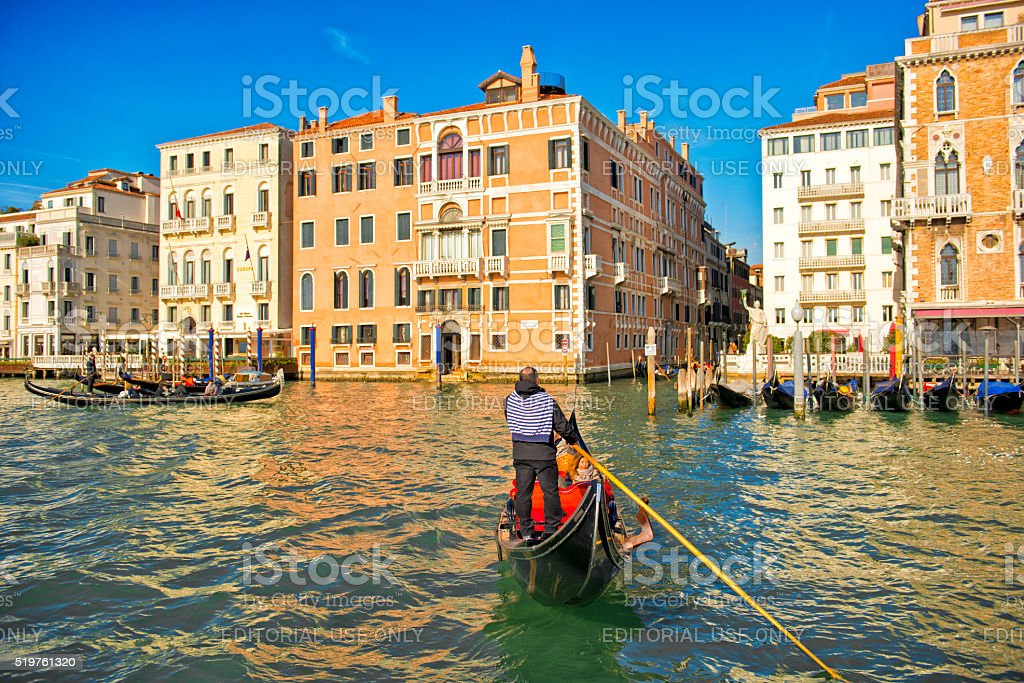 Gondola with tourists sailing in Venice stock photo