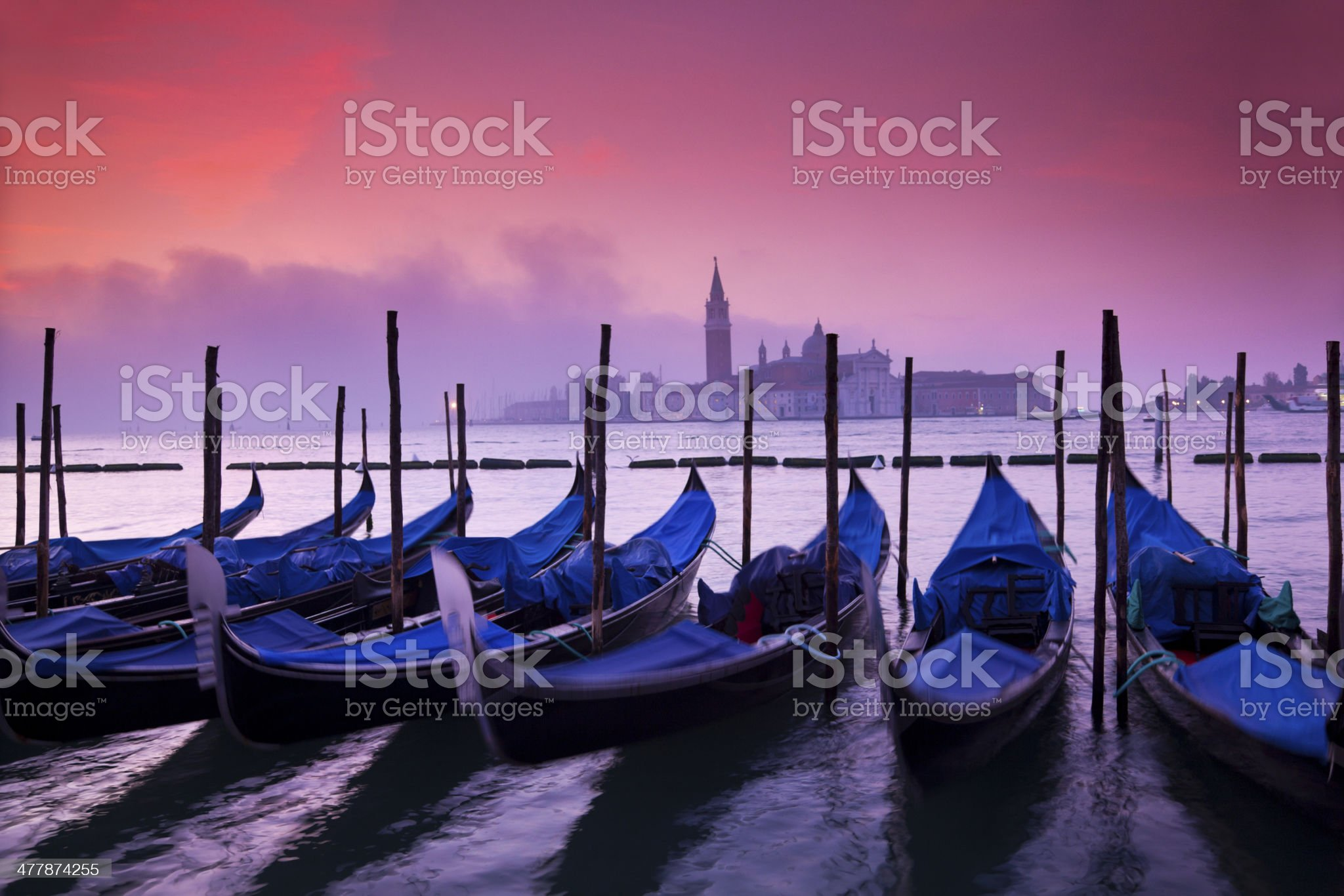Gondolas after sunset in Venice royalty-free stock photo