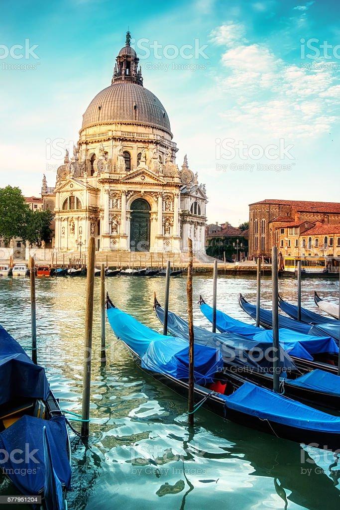 Gondolas and Basilica Santa Maria della Salute in Venice stock photo