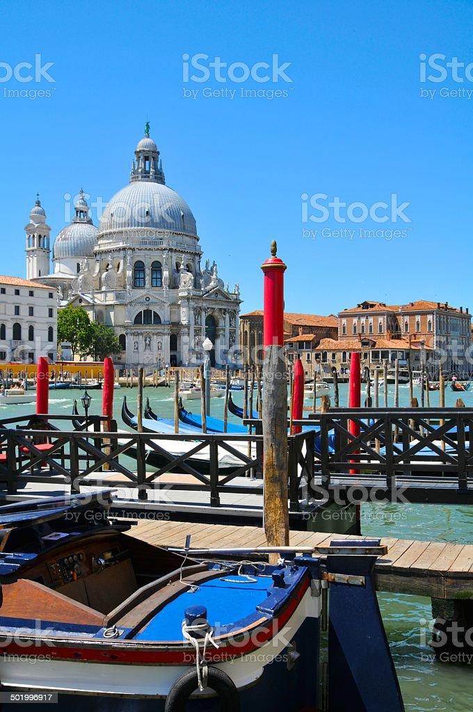 Gondolas and Boats docked at Venice Grand Canal royalty-free stock photo