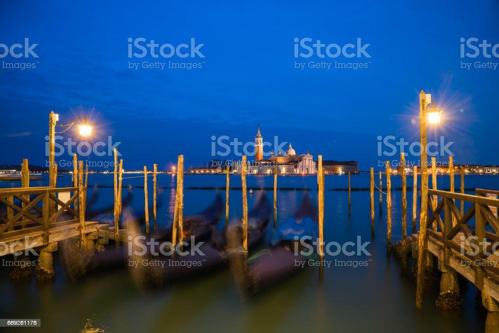 Gondolas and San Giorgio Maggiore church on Grand Canal in Venice, Italy stock photo