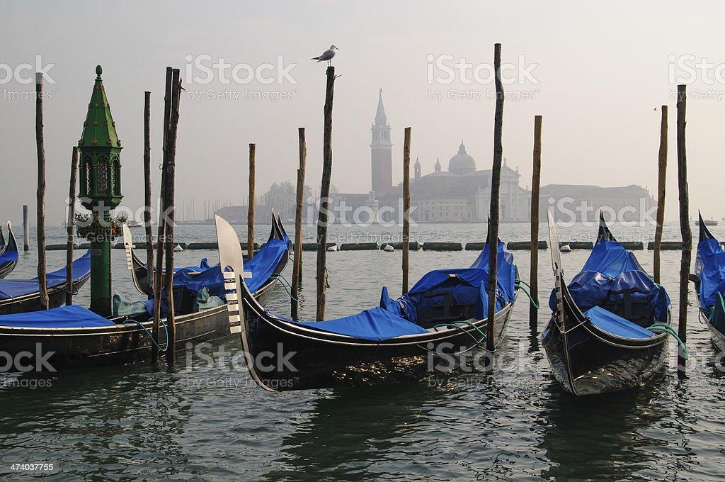Gondolas and San Giorgio Maggiore in Venice stock photo
