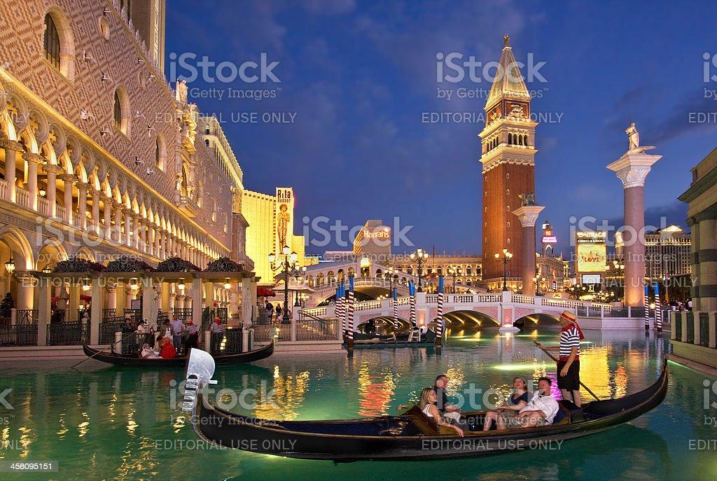 Gondolas at the Venetian Resort lagoon at night stock photo